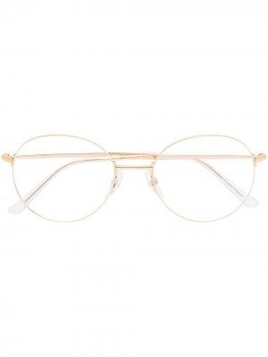 Очки в круглой оправе Balenciaga Eyewear. Цвет: золотистый