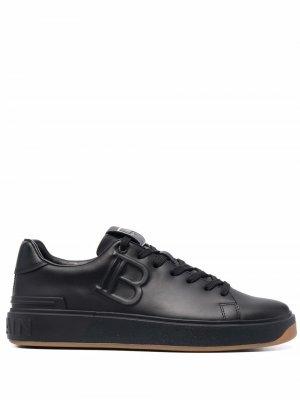 Кроссовки с тисненым логотипом Balmain. Цвет: черный