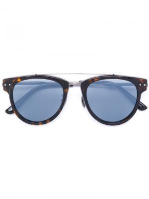 Солнцезащитные очки в круглой оправе Bottega Veneta Eyewear. Цвет: коричневый