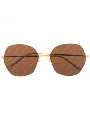 Массивные солнцезащитные очки с логотипом Balenciaga Eyewear. Цвет: золотистый
