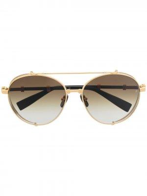 Солнцезащитные очки Brigade в круглой оправе Balmain Eyewear. Цвет: золотистый