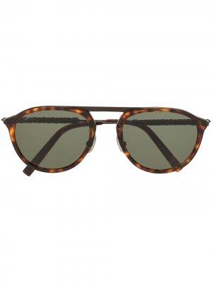 Tods солнцезащитные очки черепаховой расцветки Tod's. Цвет: коричневый
