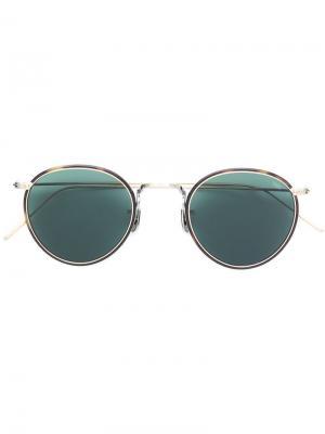 Солнцезащитные очки в круглой оправе с эффектом черепашьего панциря Eyevan7285. Цвет: золотистый