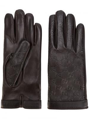 Перчатки с тисненым узором GG Supreme Gucci. Цвет: коричневый