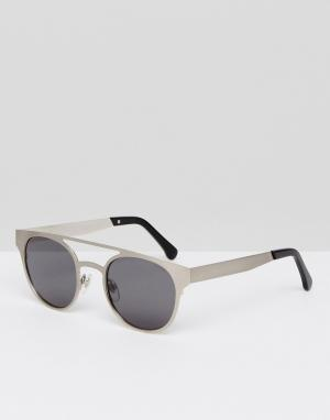 Круглые солнцезащитные очки с двойной планкой Finley Komono. Цвет: серебряный