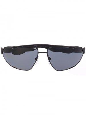Солнцезащитные очки в овальной оправе Prada Eyewear. Цвет: черный