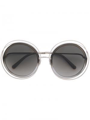 Солнцезащитные очки в круглой оправе Chloé Eyewear. Цвет: металлический