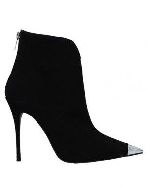 Полусапоги и высокие ботинки CARRANO. Цвет: черный