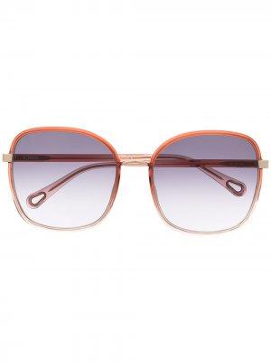 Солнцезащитные очки в массивной оправе Chloé Eyewear. Цвет: красный