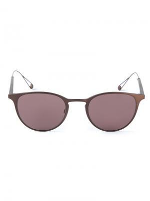 Солнцезащитные очки в овальной оправе Garrett Leight. Цвет: коричневый