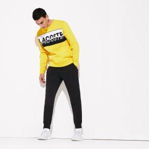 Спортивные штаны Брюки и шорты Lacoste. Цвет: none