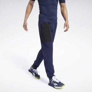Спортивные брюки Tapered Stretch Woven Reebok. Цвет: vector navy