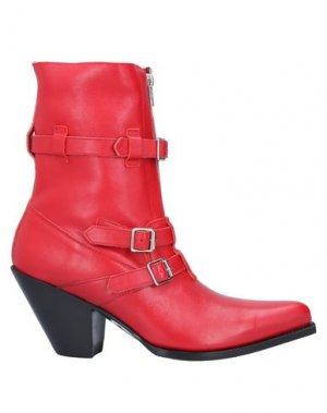 Полусапоги и высокие ботинки CELINE. Цвет: красный