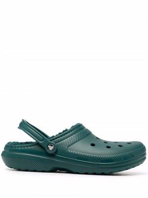 Сандалии с ремешком на пятке Crocs. Цвет: зеленый