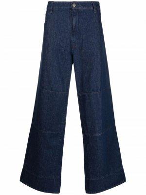 Расклешенные джинсы с нашивкой-логотипом Raf Simons. Цвет: синий
