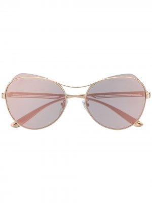 Солнцезащитные очки в круглой оправе Bulgari. Цвет: золотистый