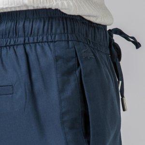 Брюки и шорты Lacoste. Цвет: none