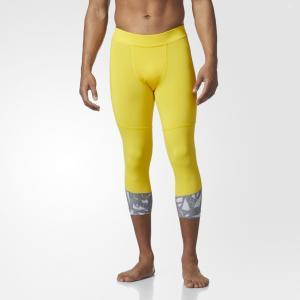 Леггинсы Essentials Performance adidas. Цвет: желтый