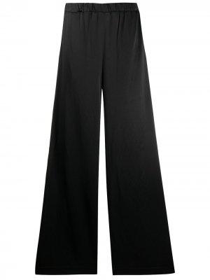 Расклешенные брюки с эластичным поясом La Collection. Цвет: черный