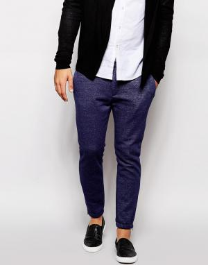 Элегантные зауженные спортивные брюки из первосортного трикотажа ASOS. Цвет: темно-синий